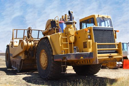 big yellow earth moving mining equipment on construction site