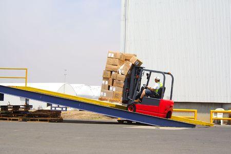 fork lift: Forklift on loading ramp