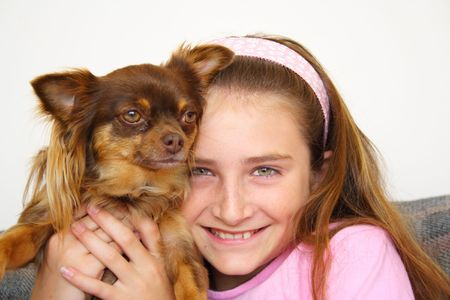 Girl and chihuahua puppy photo