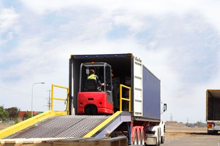 Semi truck backed onto loading ramp Stock Photo - 840837