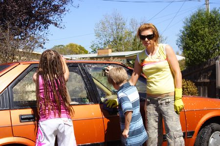 Mum and kids washing the car photo