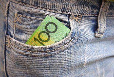 australian dollars: Australian money in jean pocket