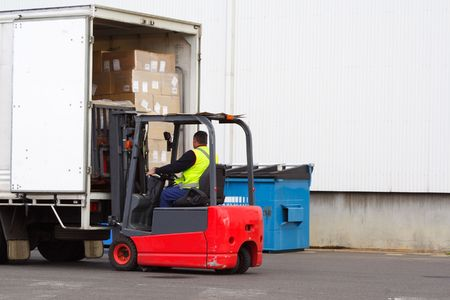 Forklift loading truck photo