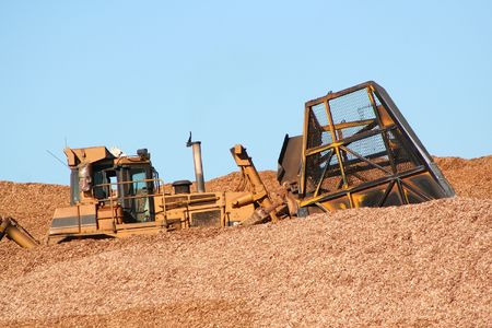 earthmover: Earthmover driving in wood chips Stock Photo