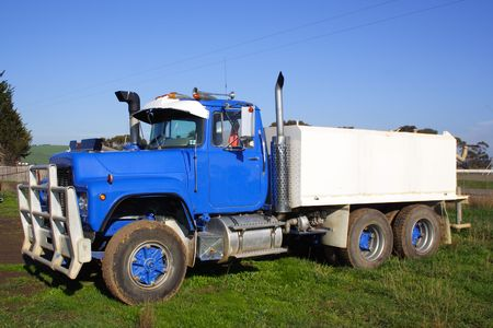 Blue small water truck