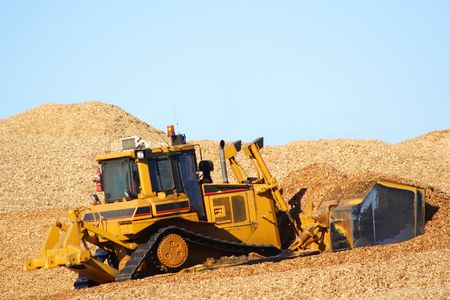 earthmover: Large earthmover with scoop of wood chips