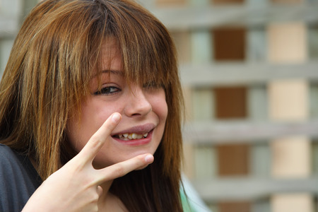 Beautiful girl with peace sign photo