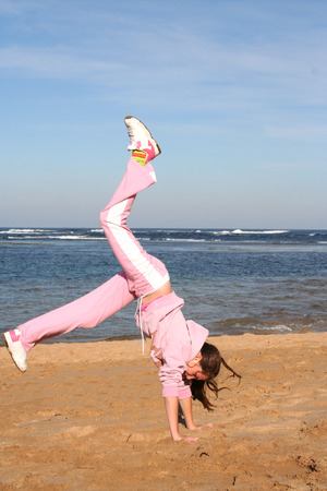Girl doing a handstand photo