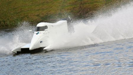 White speed boat racing through the water Banque d'images