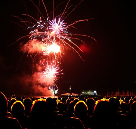 People watch fireworks display Imagens