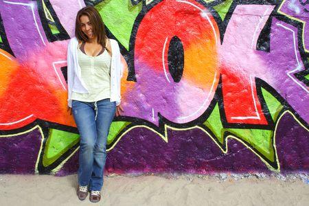 Beautiful Colombian woman with graffiti background  photo