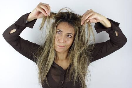 A beautiful Colombian Woman having a messy wild hair day Imagens
