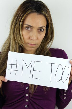 Me too social movement a latin American Woman holding a me too sign