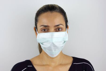 Latin American woman wearing a virus mask for the prevention of the corona virus