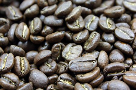 A background of dark roasted coffee beans
