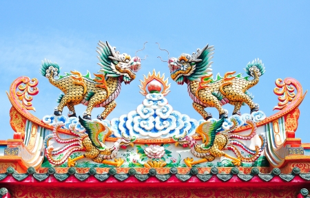 Kirin Lion statue on roof Chinese style    photo