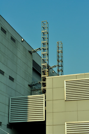 high tower for cable line between building  photo