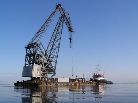 Seaport work, movement of the ships in a mouth of the river of the Baltic sea. Stock Photo