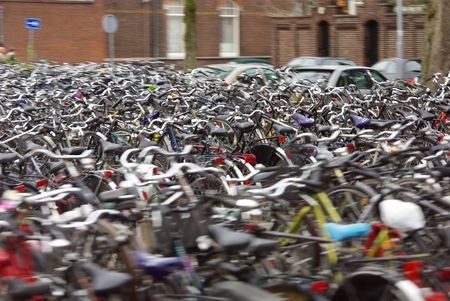 multitude: Bicycle boom of Holland, multitude of bicycles, parking Stock Photo