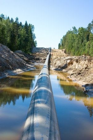 Lining of the long pipeline on a countryside Stock Photo
