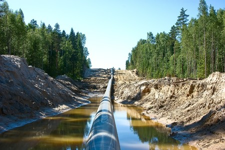 Lining of the long pipeline on a countryside Stockfoto