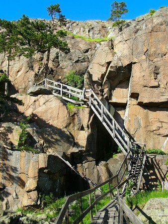 The abrupt ladder in mountainous territory coils downwards photo