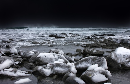 snow and ice around ocean  photo