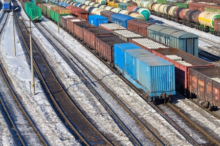 Freight cars in cargo port in the early spring photo