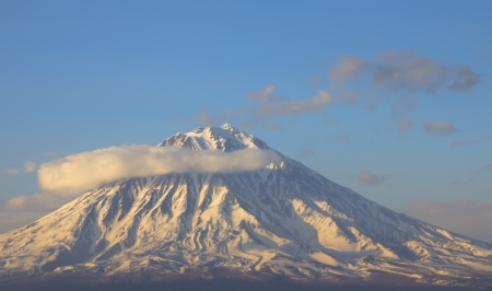 effusion: Volcano in a half ring of clouds. Are well visible barranco. Kamchatka