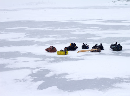 tourist backpacks in the winter on ice photo