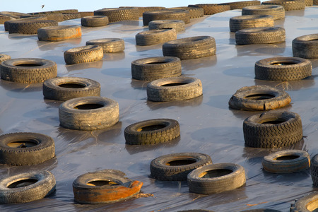 the old tires scattered on the ground photo