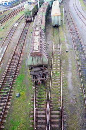 flatcar: Freight train with color cargo containers passing railway station Stock Photo
