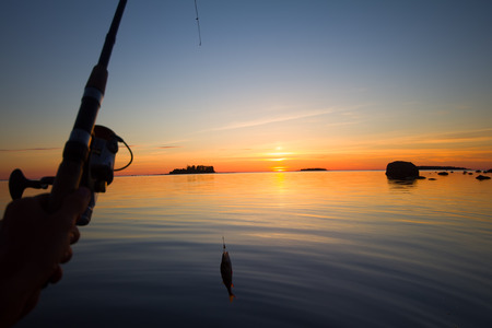 bass fishing: summer catching fishing of a perch in the evening Stock Photo