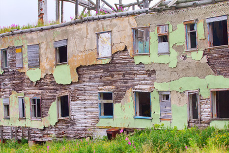collapsed abandoned house within the Arctic circle photo