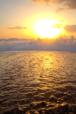 lurid: Gentle warm sea on backdrop of enchanting sunset. Foamy surf. Mediterranean sea.