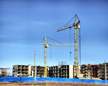 multifamily: construction site with cranes for multi-family homes Stock Photo