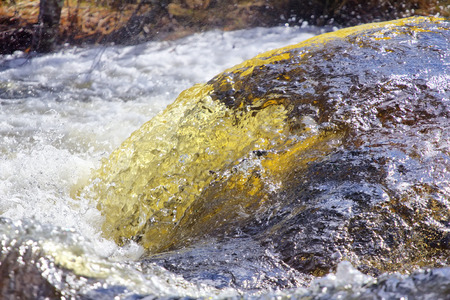 no rush: river water is a huge force rushes in front of  camera