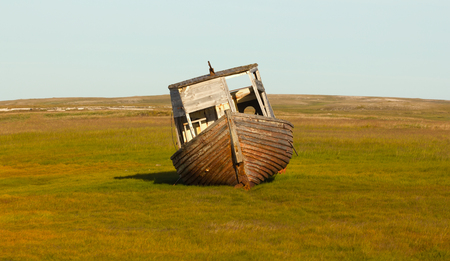 old ship: beautiful old ship thrown out at sea tundra meadow on shores of Barents Sea