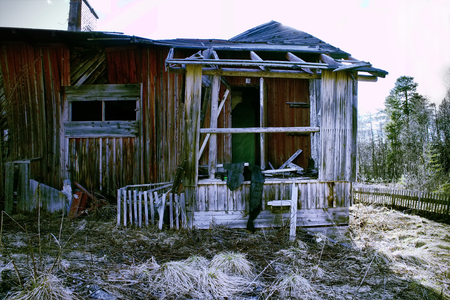 decrepitude: abandoned wooden house in the village in the North Stock Photo