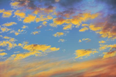 cloudiness: beautiful orange clouds lit by setting sun among gloomy cloudiness Stock Photo