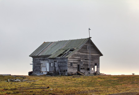 lodge: wooden hunting Lodge in open tundra, partially destroyed by hurricane