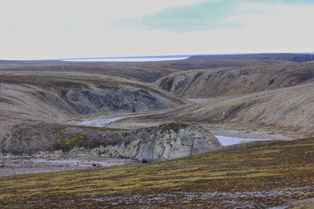 radiation pollution: Valley of river flowing through the cuesta of Novaya Zemlya archipelago. Territory of atomic test site, where conducted explosions above ground Stock Photo