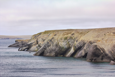 coastal erosion: Coastal erosion on Novaya Zemlya archipelago, Barents sea: erosion and formation of caves, arches, zoomorph capes, architectural forms Stock Photo