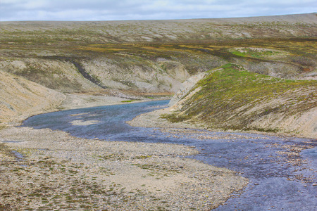 standoff: Valley of river flowing through the cuesta of Novaya Zemlya archipelago. Territory of atomic test site, where conducted explosions above ground Stock Photo