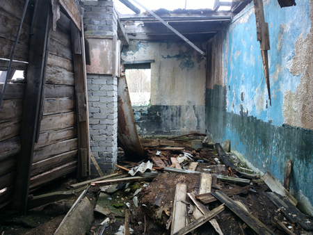 devastated: abandoned wooden house in the village in the North Stock Photo