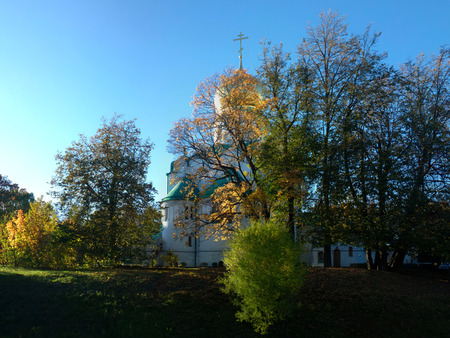 the orthodox church: yellow trees on background of Russian Orthodox Church Stock Photo