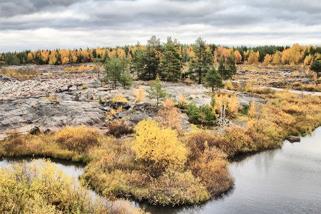 floatable: A rare opportunity to see dry rocky bottom of  river and covered with yellow leaves Northern forest Stock Photo