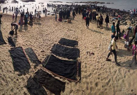 dhoti: India, kanniyakumari - January 16, 2016:   beach of the three seas or the most southern point of India