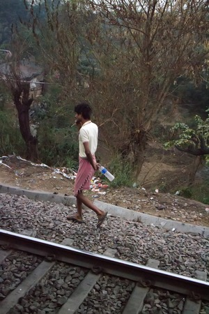 nagpur: India, Nagpur - February 20, 2016: Indian beggar in search of water goes along the railway
