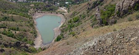 lack water: Dried out reservoir glistens silver in sun at noon. Spectacular view from top